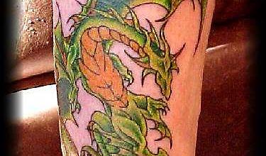 Печальный дракон - тату на ноге